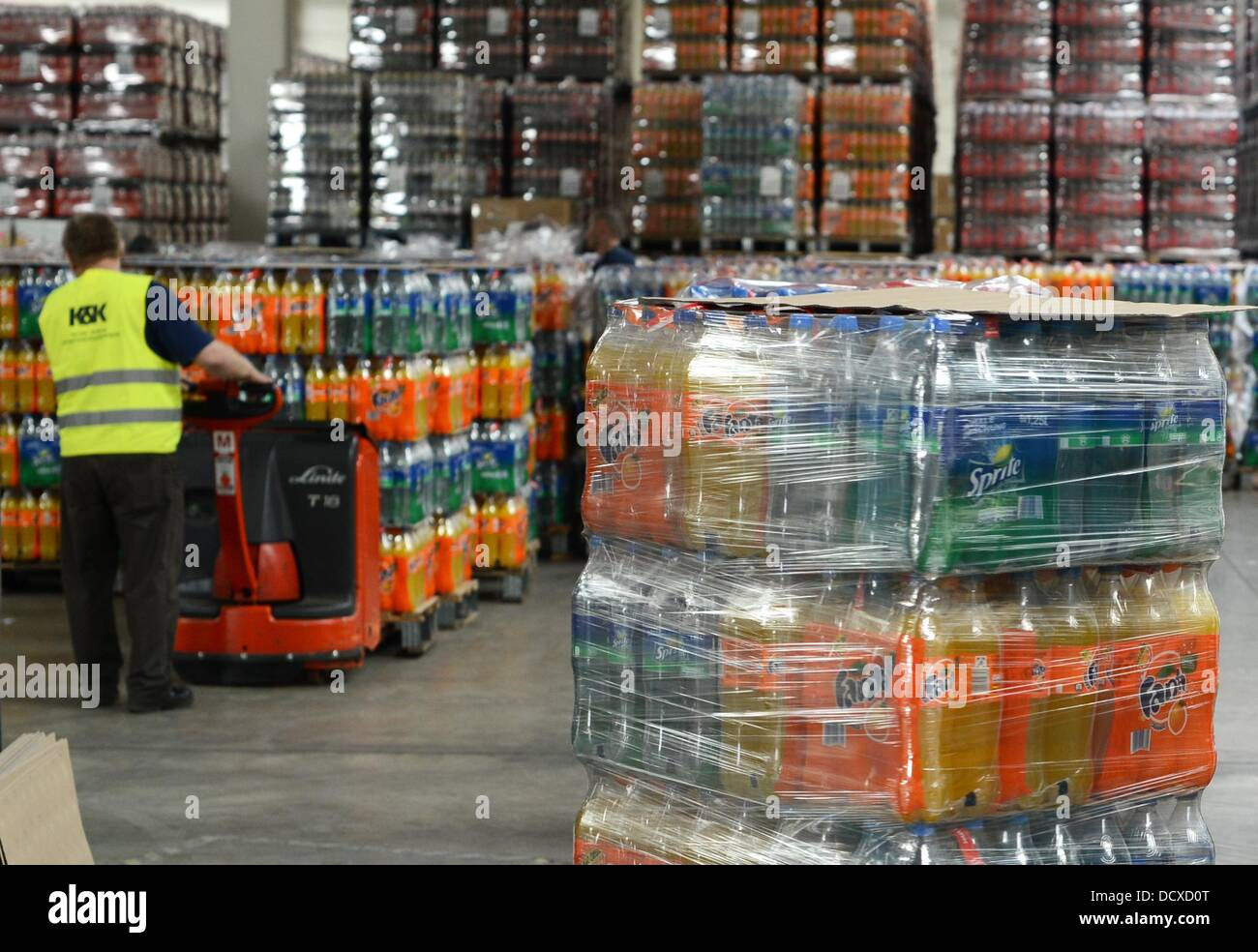Pallets with bottles are prepared for delivery in the distribution ...