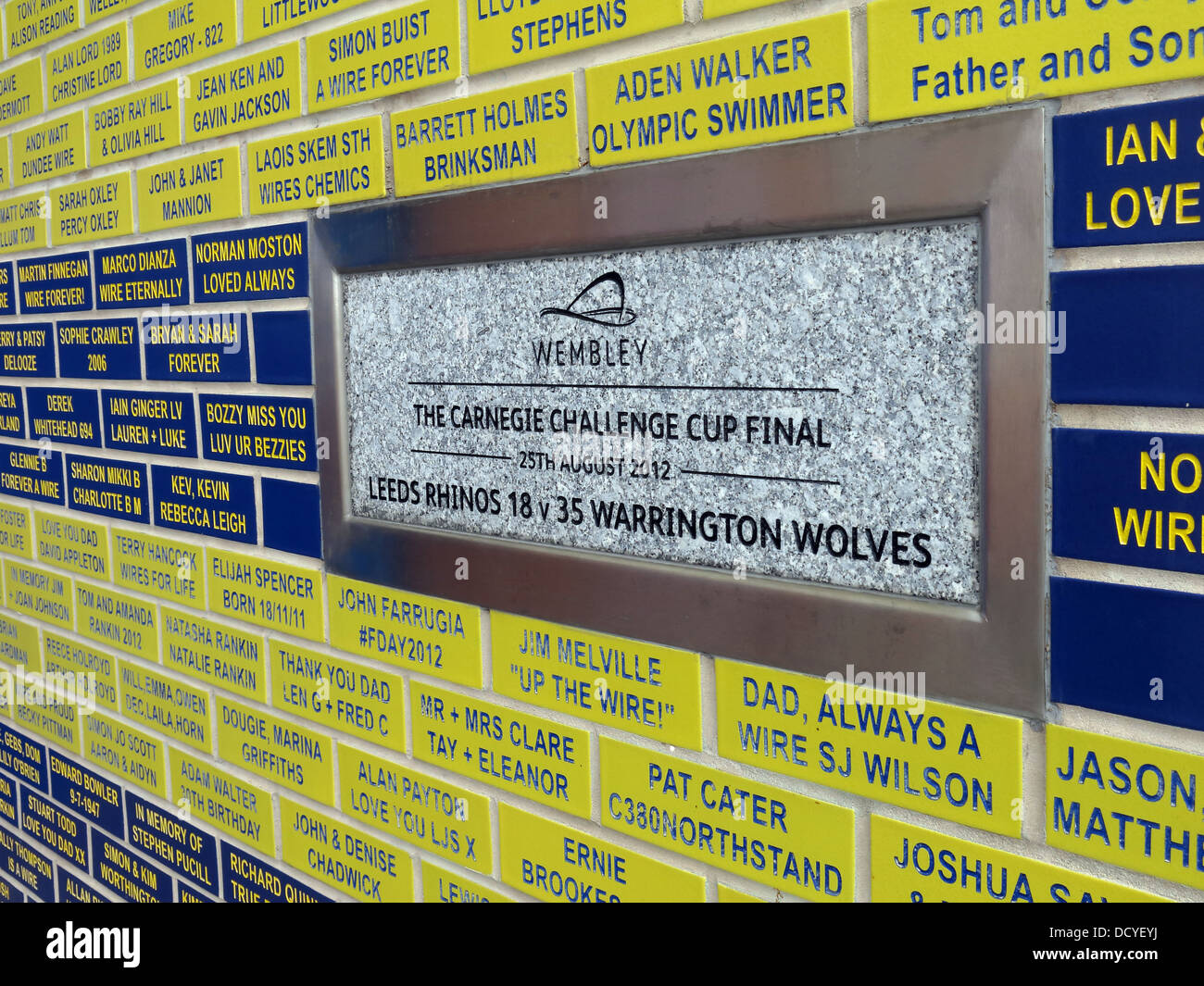 Halliwell,Jones,stadium,Mike,Gregory,Way,/,Winwick,Rd,Warrington,WA2,7NE,memorial,plaque,with,wire,wires,supporters,bricks,yellow,primrose,blue,sport,sporting,cheshire,NW,England,north,west,UK,Gotonysmith,Warringtonians,Buy Pictures of,Buy Images Of