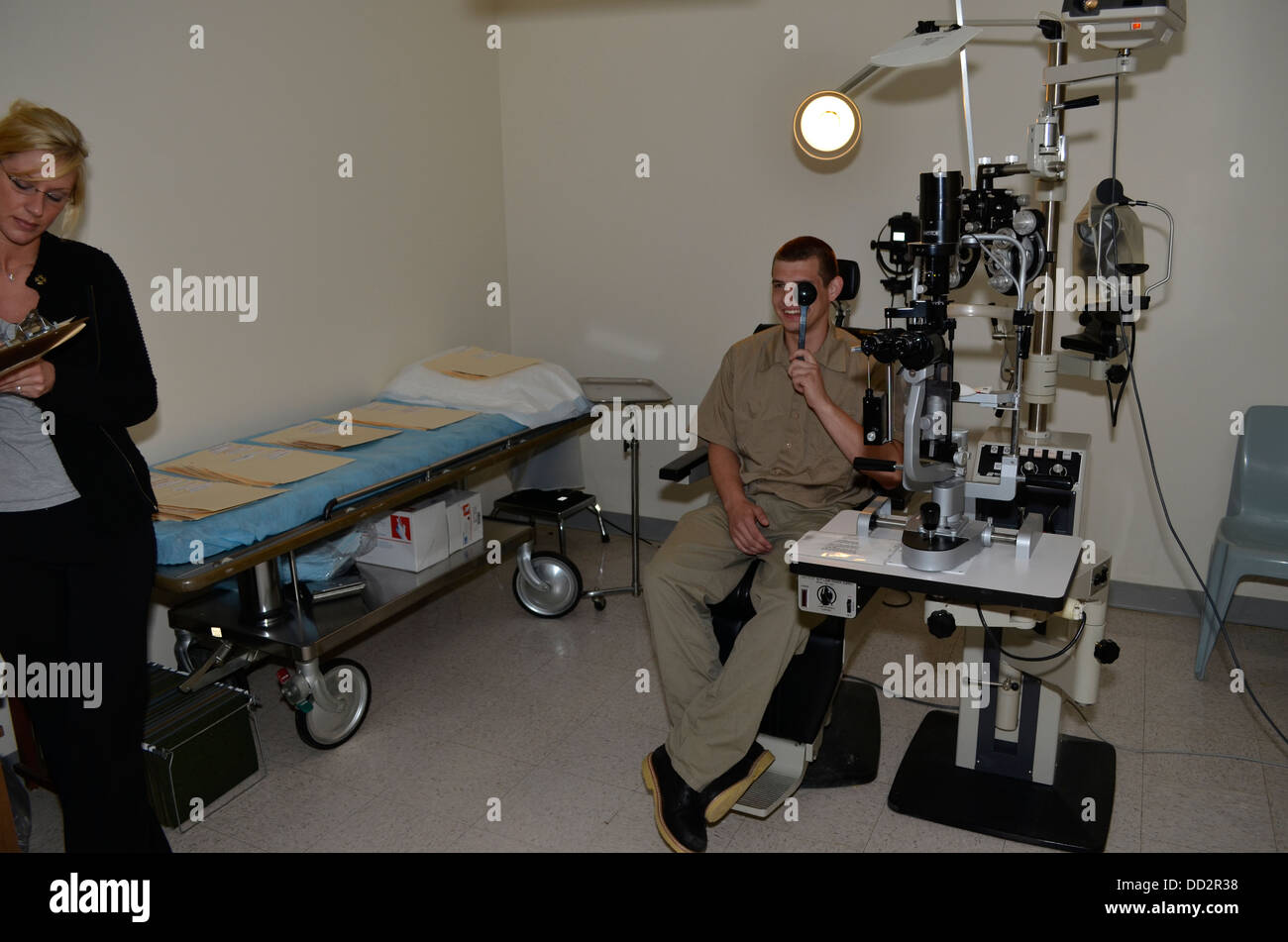 Eye exam of inmate inside American maximum security prison. Medical care are provided to inmates inside or outside - Stock Image