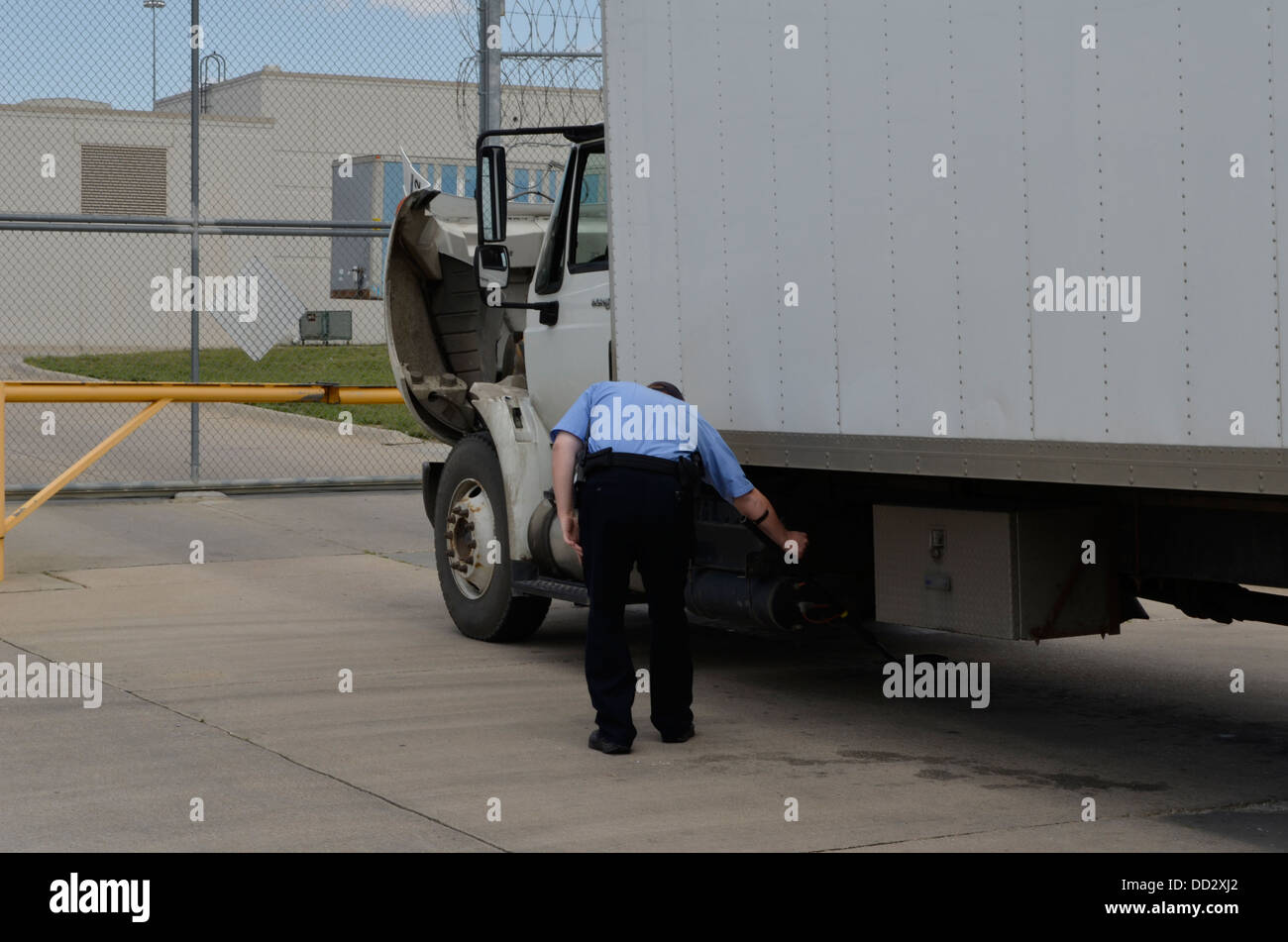Officer searching vehicle about to enter an American maximum security prison for juvenile offenders. - Stock Image