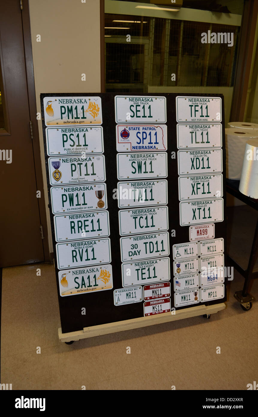 Vehicle license plates are still manufactured at the Nebraska State Penitentiary in Lincoln. These days the process - Stock Image