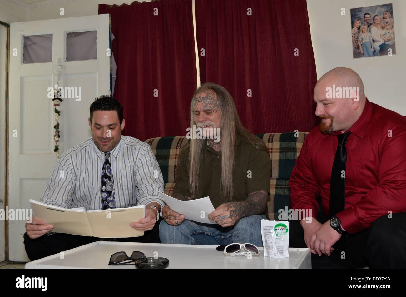 Male Adult Parole officers meeting with male parolee. - Stock Image