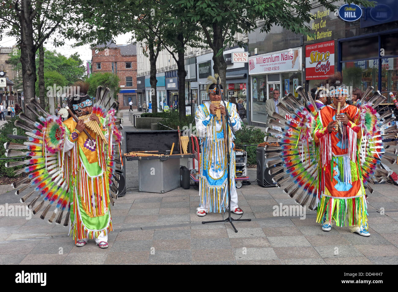 Warrington town centre,Cheshire,England,UK,GB,European,Peru,colourful,colorful,costumes,dancer,player,players,city,village,shopping,st,street,streets,playing,music,pan,pipe,panpipe,panpipes,doing,a,show,performing,red,yellow,green,golden,square,WBC,borough,council,local,authority,busking,beg,gotonysmith,cash,begging,begger,entertainment,fun,joy,funny,cheering,up,shoppers,Buy Pictures of,Buy Images Of