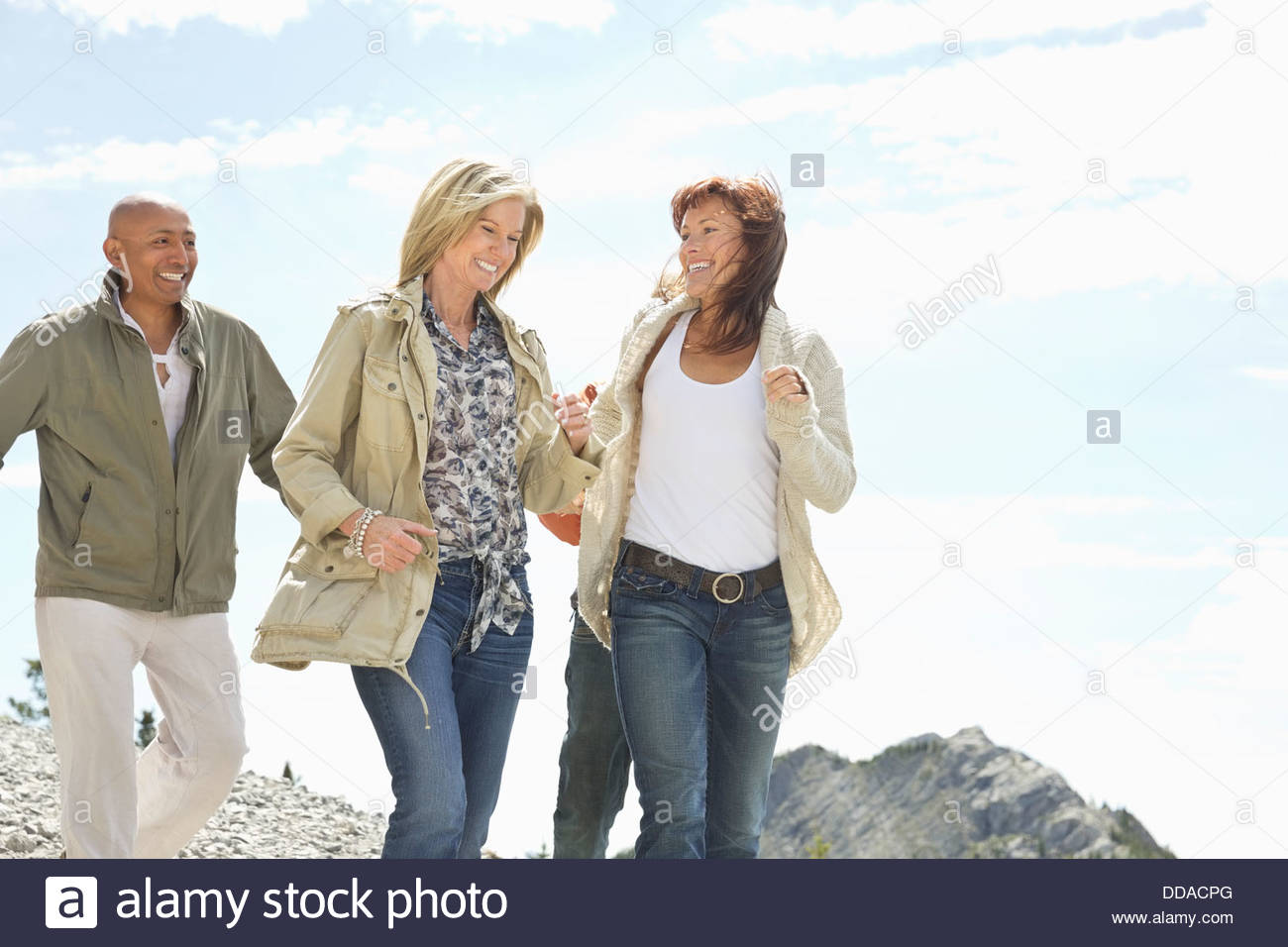 Cheerful mature friends having fun outdoors - Stock Image
