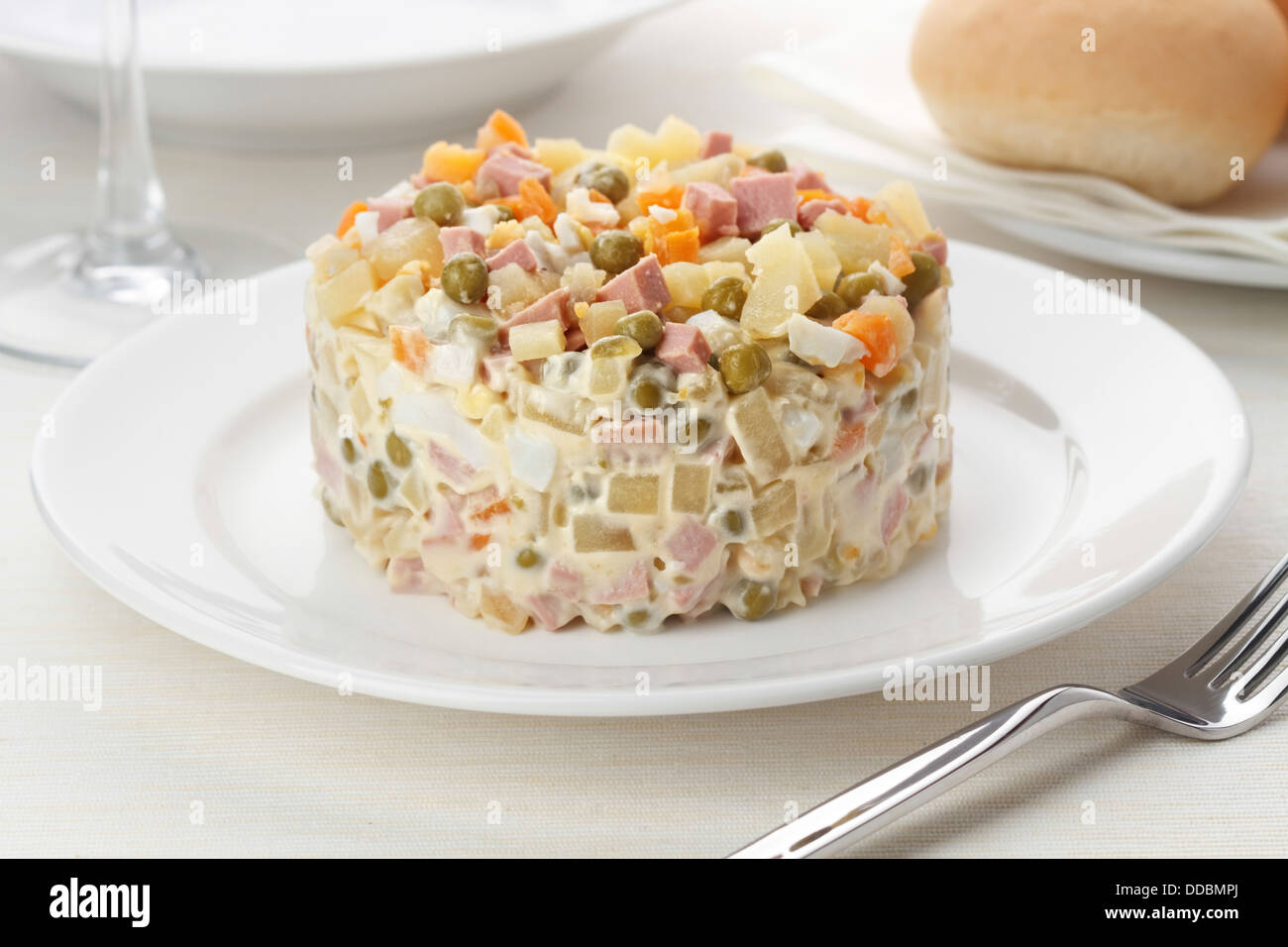 Russian traditional salad olivier with pea - Stock Image