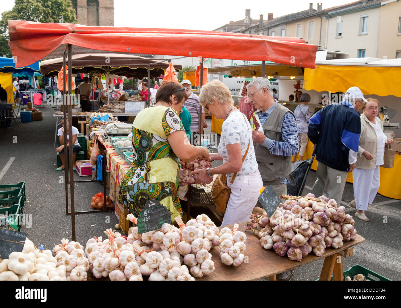 People Buying Garlic In A Traditional French Town Market St