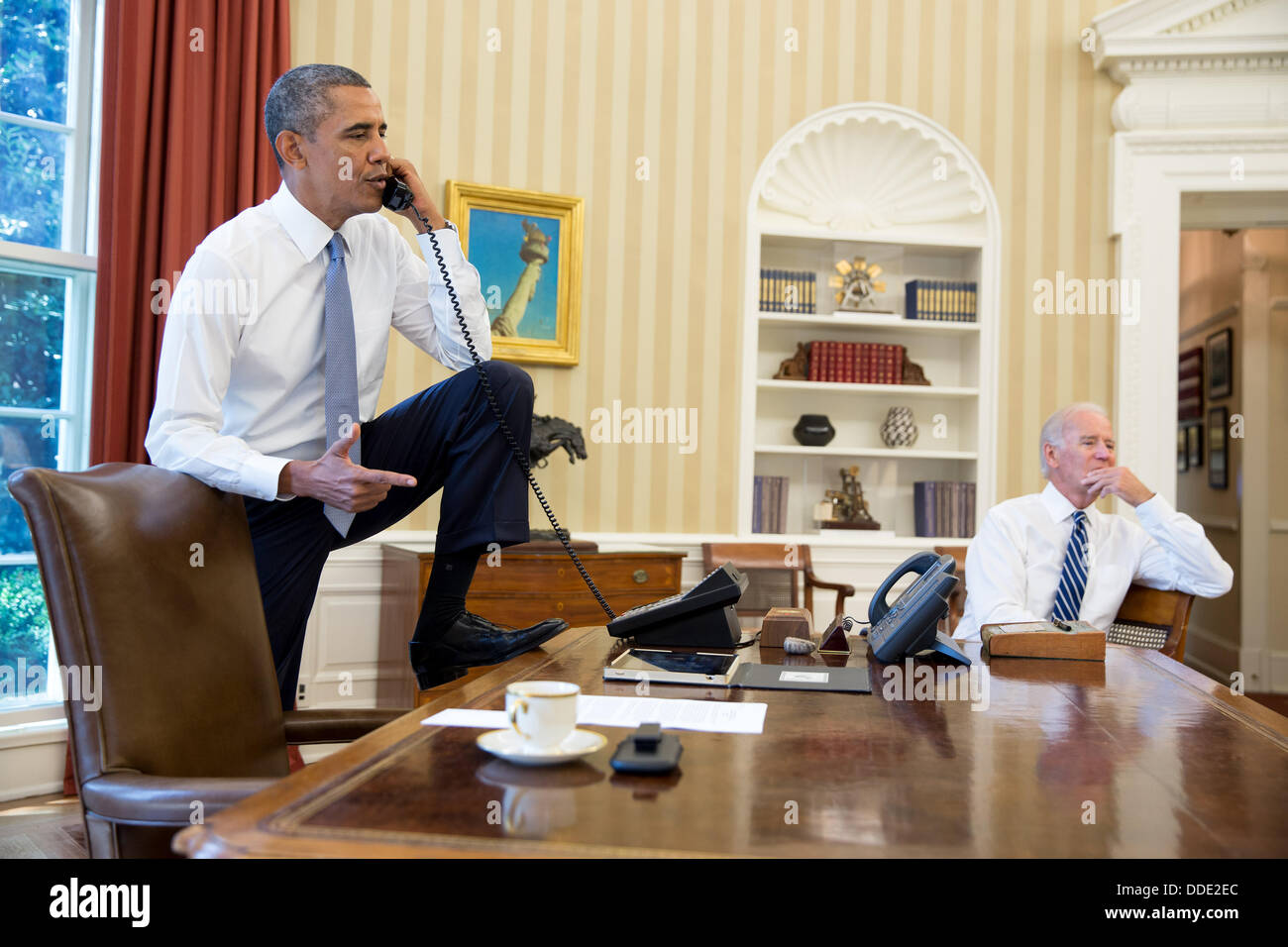 obama oval office. us president barack obama talks on the phone in oval office with speaker of house john boehner situation syria as vice joe biden s