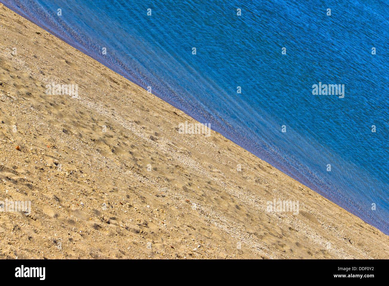 Sand beach and blue sea diagonal layers - Stock Image