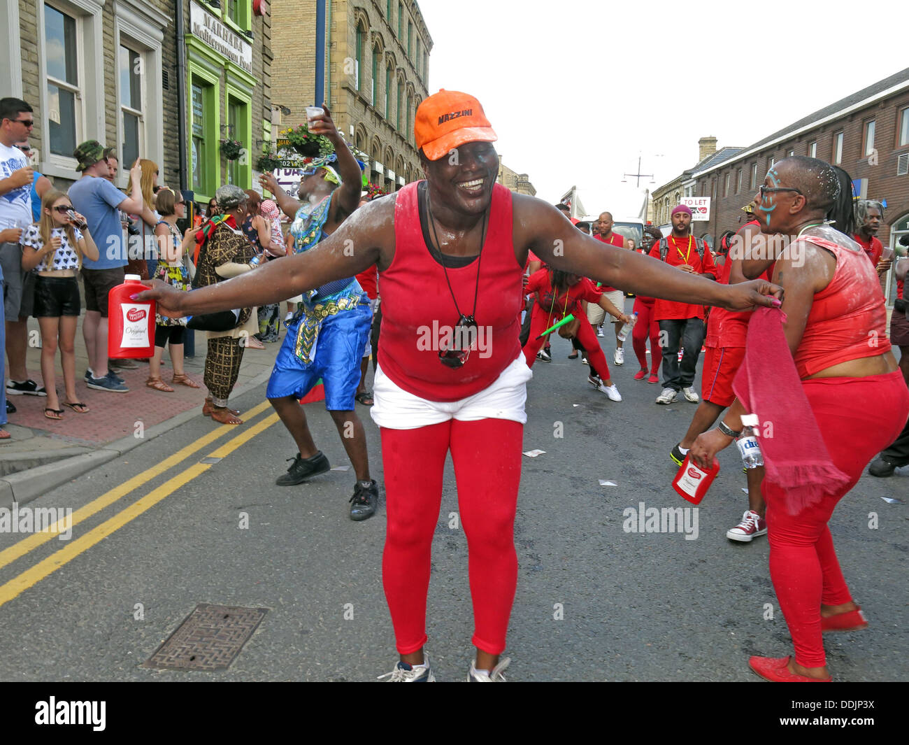 Kirklees,council,local,authority,LA,West,Yorkshire,England,English,UK,GB,Great,Britain,British,town,centre,Saturday,13th,July,event,HACCT,office,African-Caribbean,African,Caribbean,Afro,dancer,dancers,Masqueraders,costume,colourful,Hudawi,trust,diversity,diverse,events,leisure,activities,activity,Gotonysmith,red,sun,sunny,day,summer,center,13/07/2013,Greenhead,Park,Afro-Caribbean,costumes,colorful,culture,cultural,streets,parades,jab,jabs,jab-jabs,St,Johns,Rd,from,Willow,Lane,to,John,William,St,Johns,Rd,Market,Place,Cloth,Hall,St,from,Market,Place,to,St,from,Cloth,Hall,St,to,Westgate,from,to,Trinity,St,johns,Yorks,WestYorks,HD11NU,1NU,Buy Pictures of,Buy Images Of