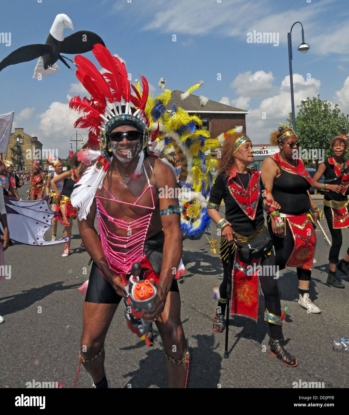 Kirklees,council,local,authority,LA,West,Yorkshire,England,English,UK,GB,Great,Britain,British,town,centre,Saturday,13th,July,event,HACCT,office,African-Caribbean,African,Caribbean,Afro,dancer,dancers,Masqueraders,costume,colourful,Hudawi,trust,diversity,diverse,events,leisure,red,activity,Gotonysmith,sun,sunny,day,summer,center,13/07/2013,Greenhead,Park,Afro-Caribbean,costumes,colorful,culture,cultural,streets,parades,jab,jabs,jab-jabs,St,Johns,Rd,from,Willow,Lane,to,John,William,St,Johns,Rd,Market,Place,Cloth,Hall,St,from,Market,Place,to,St,from,Cloth,Hall,St,to,Westgate,from,to,Trinity,St,johns,Yorks,WestYorks,HD11NU,1NU,headdress,head,dress,head-dress,Buy Pictures of,Buy Images Of