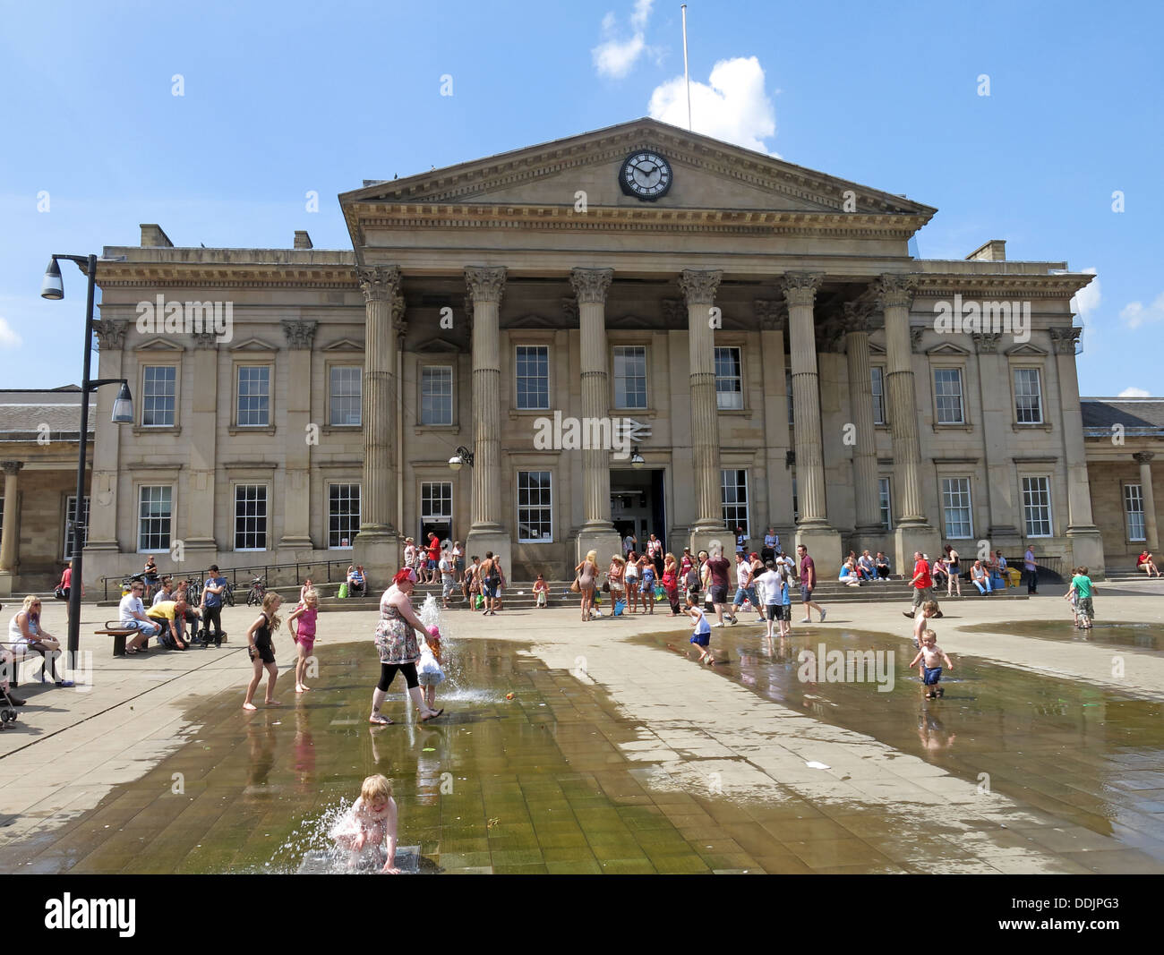 Huddesfield,fountain,fountains,summer,sunny,sun,sunshine,daytime,2013,St,Georges,George,saint,ST.,sq,square,West,Yorks,Yorkshire,England,UK,GB,great,Britain,town,Harold,Wilson,statue,bronze,Hudds,Huds,HD11JY,HD1,1JY,popular,kirklees,kirklees,local,authority,council,head,of,steam,pub,ale,train,gotonysmith,trail,aletrail,CAMRA,real,beer,historic,heart,of,water,feature,architect,James,Pigott,Ptitchett,classical,style,facade,with,a,portico,of,the,Corinthian,order,consisting,of,six,columns,in,width,and,two,in,depth,facing,out,towards,Lion,Buildings,most,famous,son,Ian,Walters,sculpture,Buy Pictures of,Buy Images Of