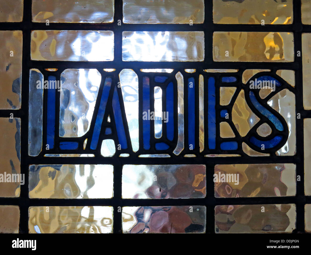 lady,ladys,ornate,pub,bar,public,house,english,british,GB,great,britain,light,coming,through,day,light,daylight,afternoon,toilets,doorway,entrance,to,a,gotonysmith,Buy Pictures of,Buy Images Of