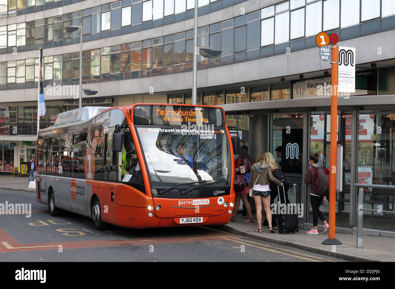 Piccadilly,railway,red,at,bus,stop,shuttle,free,bus,system,that,operates,in,Manchester,city,centre,and,Bolton,and,Stockport,town,centres,all,in,Greater,England,queue,queues,red,silver,MetroShuttle,optare,1,one,deansgate,china,town,freebus,buses,gotonysmith,Buy Pictures of,Buy Images Of