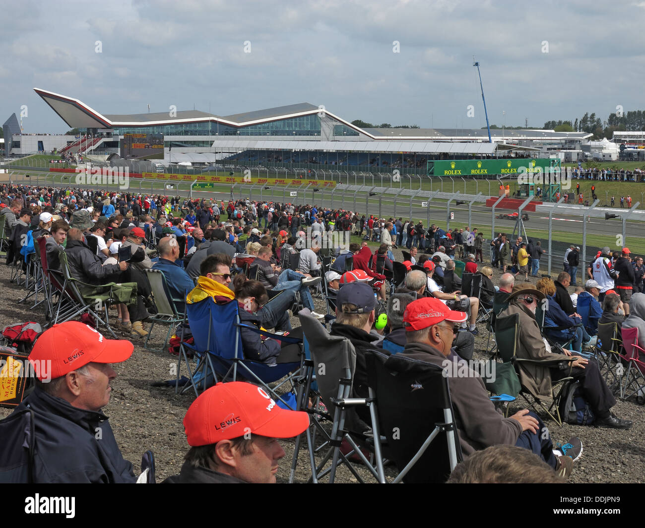 England,UK,Great,Britain,motor,racing,sport,motorsport,camping,stand,stands,spectator,watching,watcher,ticket,tickets,June,2013,Northampton,Northamptonshire,motorracing,event,circuit,Formula,One,World,Championship,spectator,trackside,track,side,campers,seated,waiting,for,the,race,vodafone,redhat,hat,Gotonysmith,events,prestige,prestigious,Lewis,Hamilton,NN12,8TN,NN128TN,hats,wait,patiently,practice,day,Saturday,Friday,Sunday,race,main,Buy Pictures of,Buy Images Of