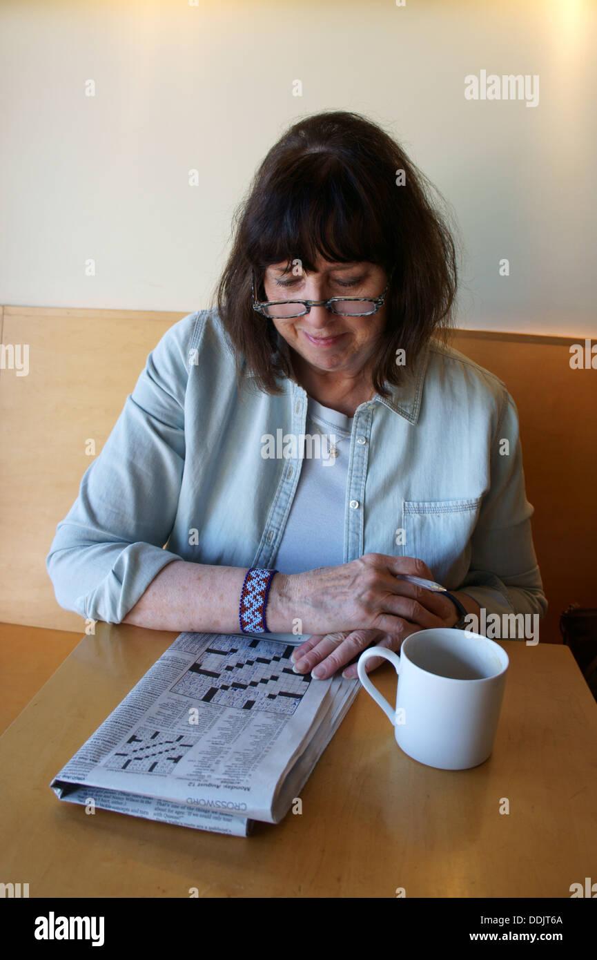 older-woman-senior-doing-a-crossword-puz