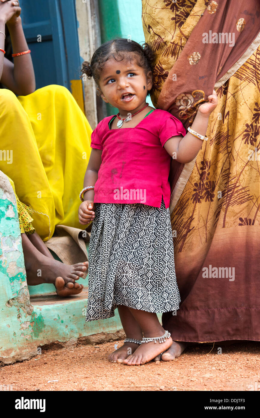 Indian infant girl and mother in a rural indian village. Andhra Pradesh, India - Stock Image