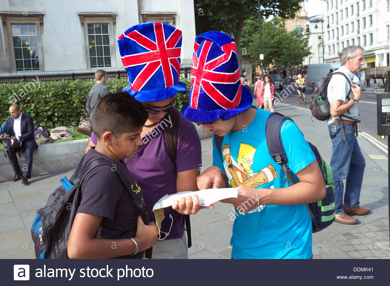 Young tourists consult their map, in Trafalgar Square, London, UK. Stock Photo