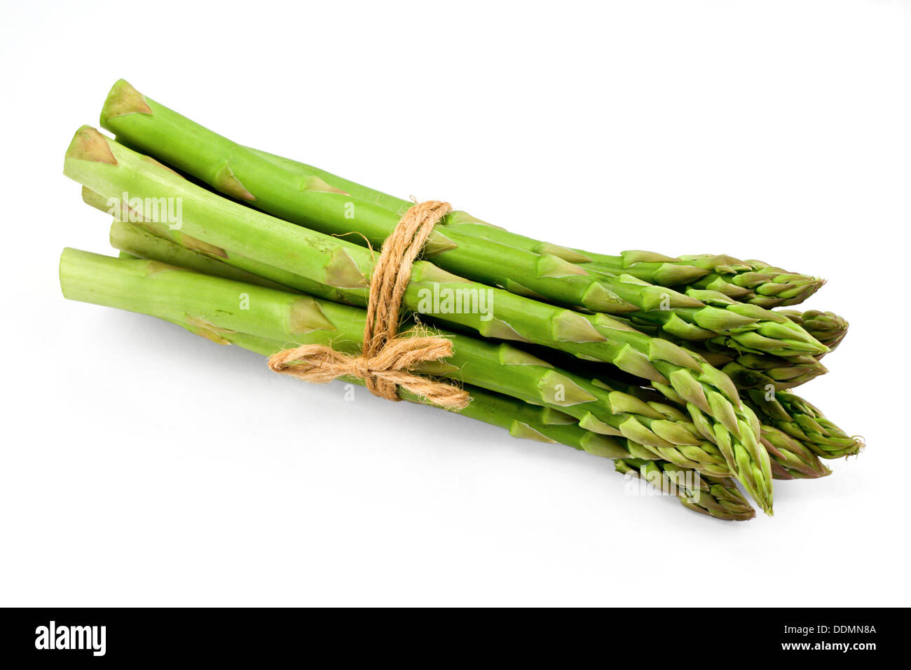 Asparagus bunch a premium seasonal vegetable isolated on a white background with light shadow - Stock Image