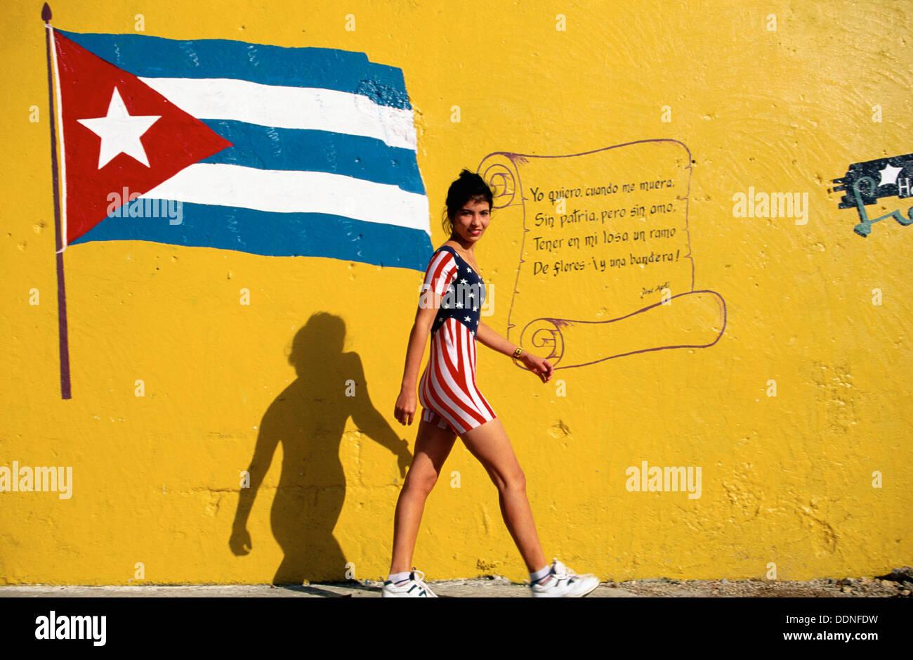 Cuba, Havana. Young woman w. american-flag suit walking close to ...
