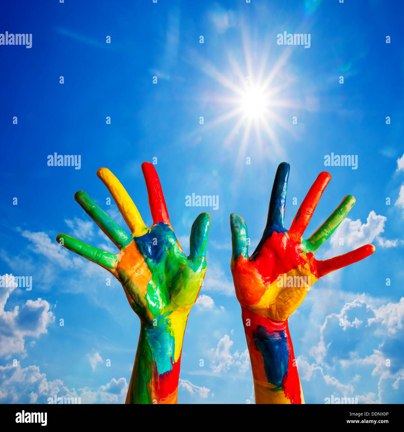 Painted hands up, colorful fun - creativity / happiness / diversity concept. - Stock Image
