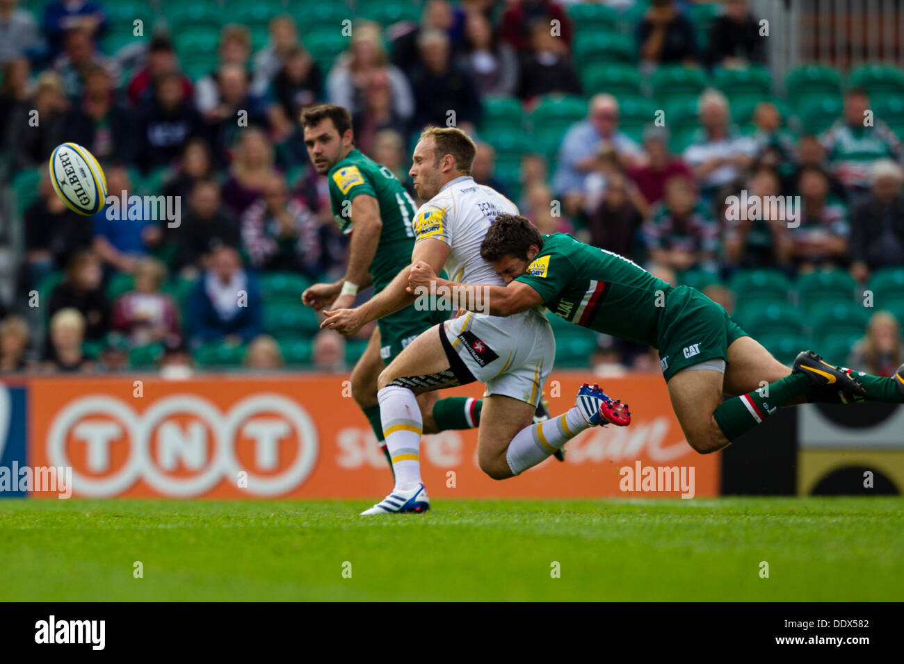 Leicester, UK. 8th Sep, 2013. Leicester's Anthony Allen makes a flying tackle. Action from the Aviva Premiership - Stock Image