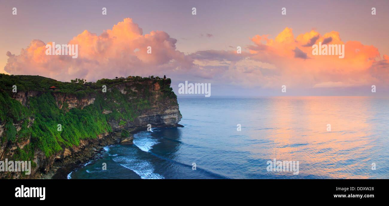 Bali, Bukit Peninsula, Uluwatu, Pura Luhur Uluwatu Temple at dawn, one of the most important directional temples - Stock Image
