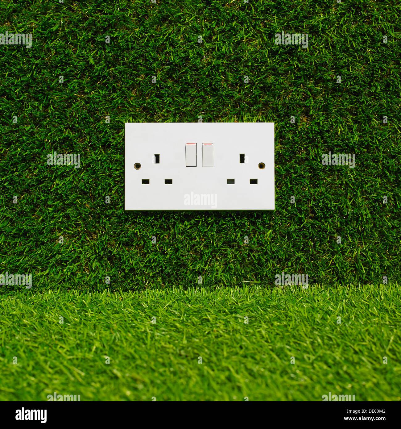Electrical Plug Socket On Grass Background. - Stock Image