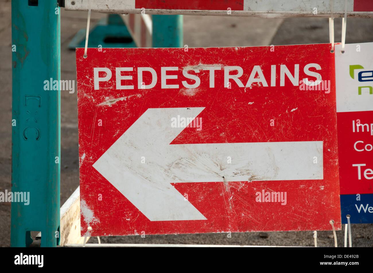Incorrect spelling on a direction sign for pedestrians, spelt 'pedestrains'.  Droylsden, Manchester, England, UK Stock Photo