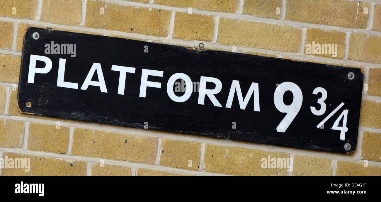 Sign for platform nine and three quarters at Kings Cross station from Harry Potter story and now a visiting point - Stock Image