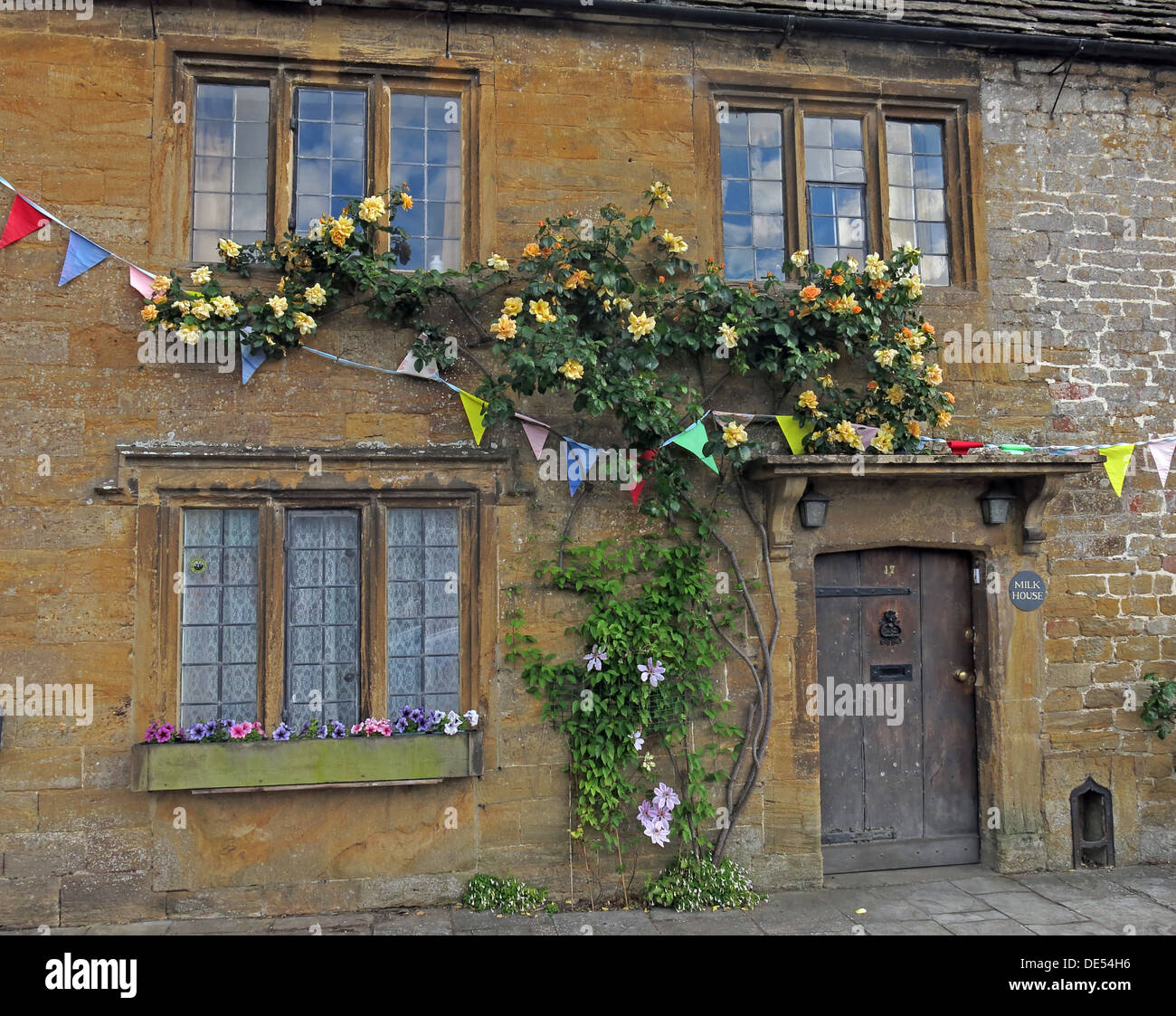 stone,building,buidings,old,olde,ros,flowers,on,front,of,history,historic,NT,National,trust,GB,England,UK,with,climbing,roses,Cottage,Milkhouse,Milk,house,home,Borough,Flowers on building,Flowers on house,Roses on house,Climbing Rose,South Somerset,The Borough,GoTonySmith,@HotpixUK,windows,door,wood,wooden,wooded,cream,sandstone,sand,stones,windows,Buy Pictures of,Buy Images Of,Images of,Stock Images,old door,Climbing Roses