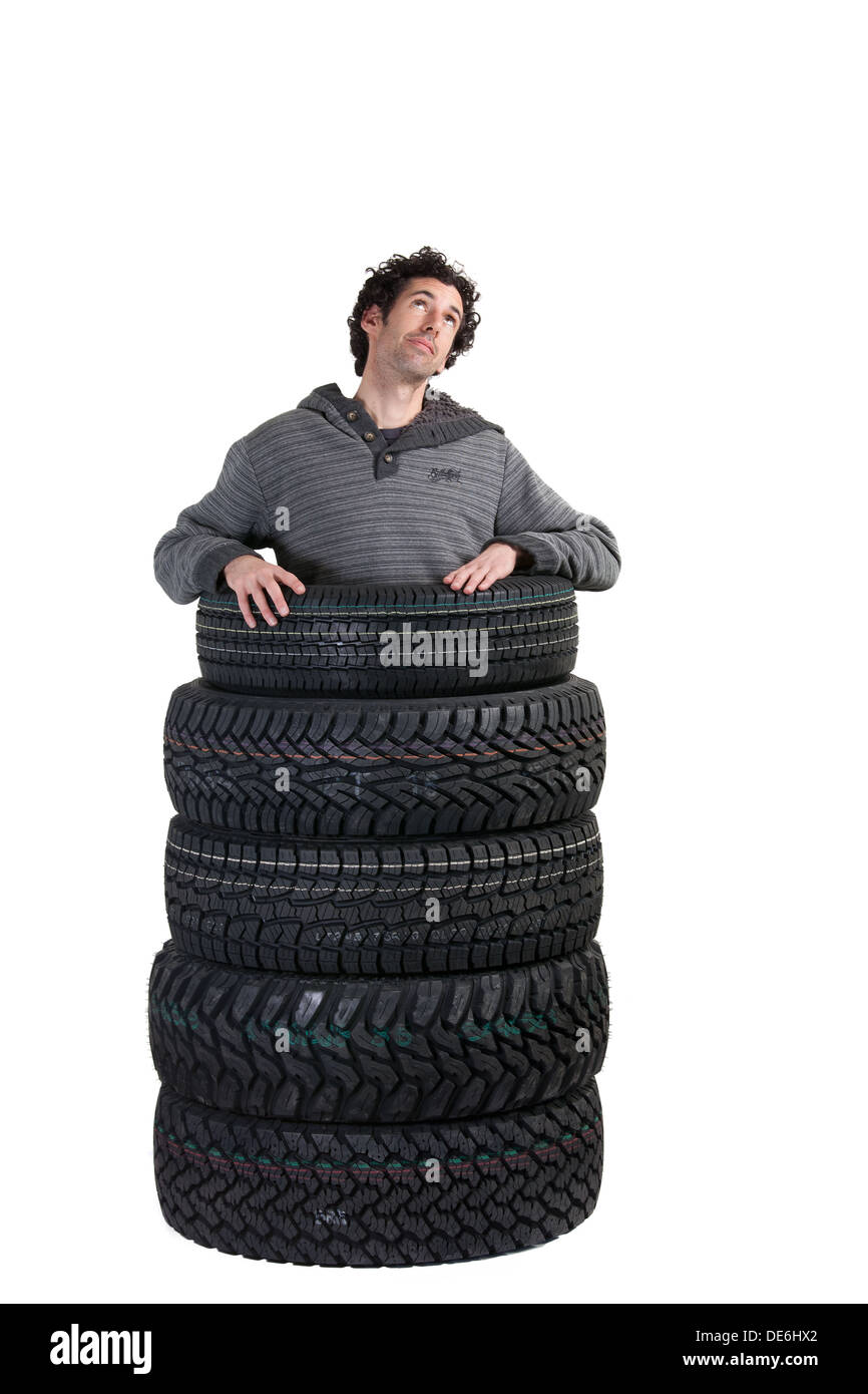 man-confused-about-buying-or-purchasing-automotive-tyres-or-tires-DE6HX2.jpg