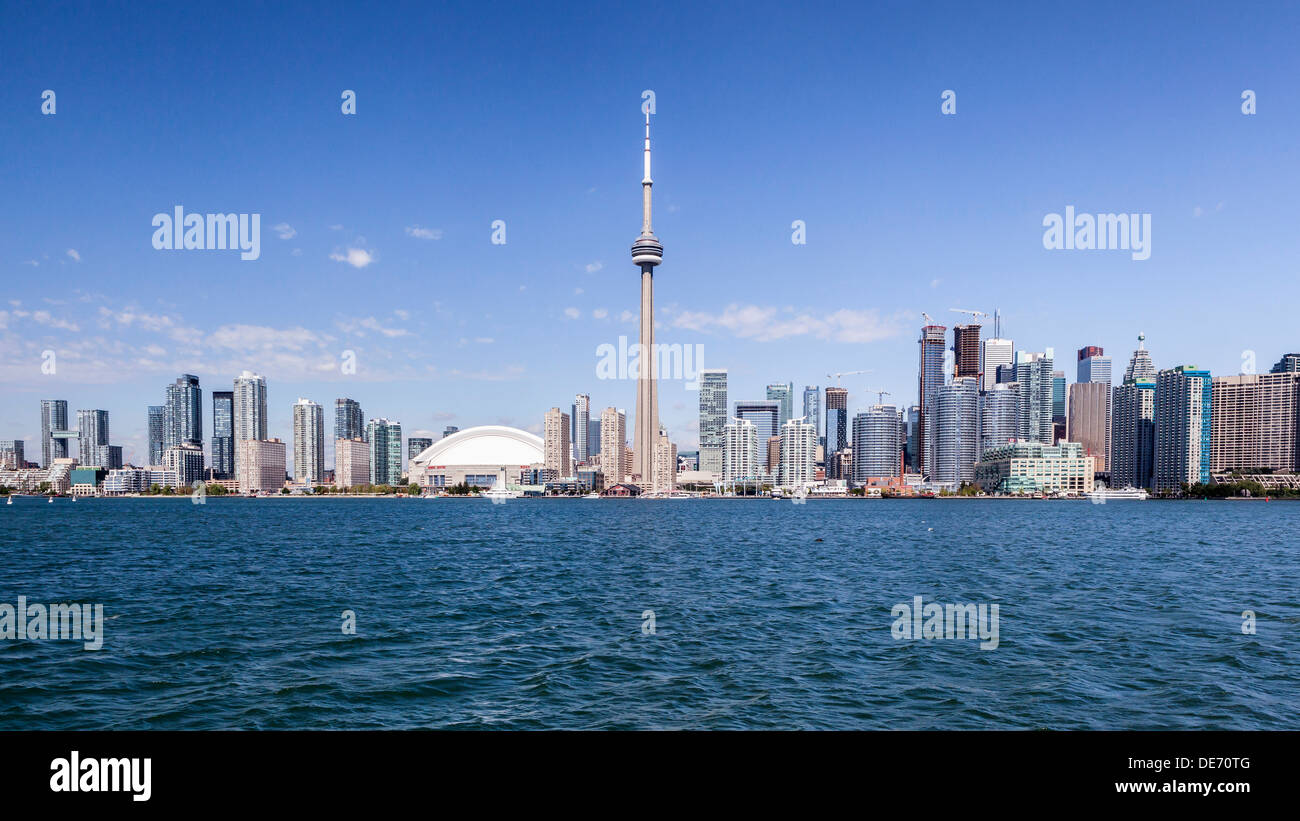 Blue sky view of Toronto skyline, Skyscrapers and CN tower from Lake Ontario - Canada - Stock Image