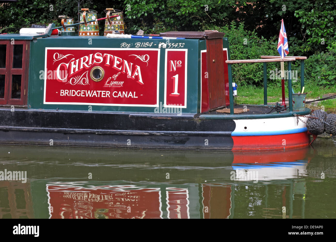 Bridgewater,Canal,boat,narrowboat,reflection,reflected,Lymm,water,in red,Grappenhall,Cheshire,England,UK,GB,United Kingdom,Great,Britain,No1,No,1,one,Number one,traditional,old,fashioned,flag,painted,barges,canals,holiday,tourist,tourism,Runcorn,Manchester,Worsley,coal,transport,old fashioned,gotonysmith,reflect,British,Waterways,Trust,Still,calm,holidays,network,festival,canal boat,canal boats,Buy Pictures of,Buy Images Of