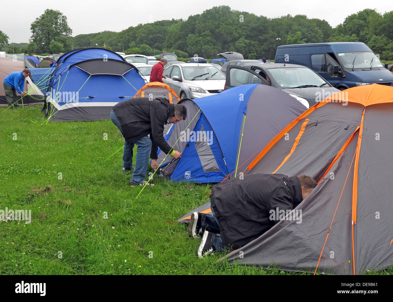 or,sporting,event,F1,Grand,Prix,British,great,Britain,glasto,silverstone,woods,wood,woodlands,field,in,a,putting,up,a,shelter,camp,sheets,of,fabric,frame,tentframe,blacks,cheap,solution,lightweight,hiking,cotton,canvas,nylon,felt and polyester campsite glamping not glamorous camping wet weather,gotonysmith inclement Silverstone Woodlands,Towcester,Northamptonshire,England,UK NN12 8TN NN128TN,Buy Pictures of,Buy Images Of
