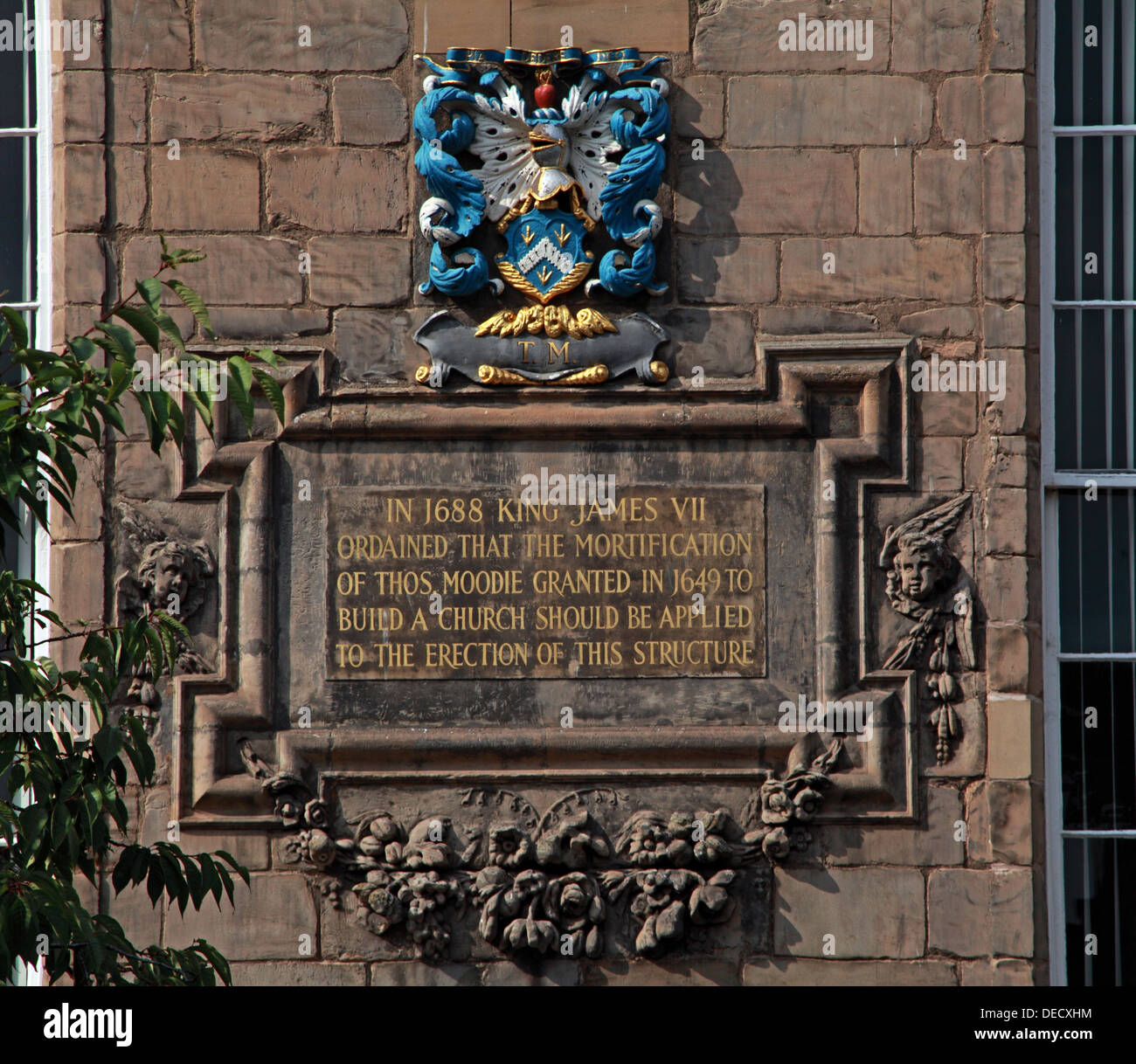 EH8,8BN,EH88BN,outside,historic,tourist,travel,building,architecture,kirkyard,churchyard,yard,Canon,gate,of,old,town,oldtown,parish,castle,cots,Scottish,scotch,burgh,city,Dutch-style,end,gable,worship,services,Sunday,anglican,religion,religion,Christianity,royal,gotonysmith,Palace,of,Holyroodhouse,Holyrood,capital,Dutch,style,small,doric-columned,portico,over,the,entrance,doric,column,columned,Regiment,of,the,British,Army,chapel,inscription,reads,read,in,1688,king,james,VII,ordained,that,the,mortification,of,oldtown,Thos.,Moodie,granted,in,1649,to,build,a,church,should,be,applied,to,the,erection,of,this,structure,Buy Pictures of,Buy Images Of