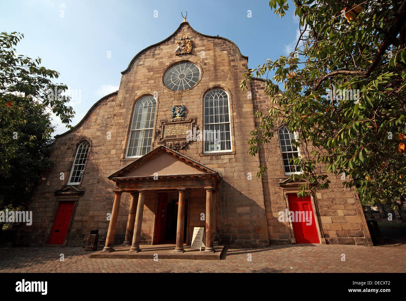 EH8,8BN,EH88BN,exterior,outside,historic,tourist,travel,building,architecture,kirkyard,churchyard,yard,Canon,gate,of,old,town,oldtown,parish,castle,cots,Scottish,scotch,burgh,city,Dutch-style,end,gable,worship,services,Sunday,anglican,religion,religion,Christianity,royal,gotonysmith,Palace,of,Holyroodhouse,Holyrood,capital,Dutch,style,small,doric-columned,portico,over,the,entrance,doric,column,columned,Regiment,of,the,British,Army,chapel,Buy Pictures of,Buy Images Of