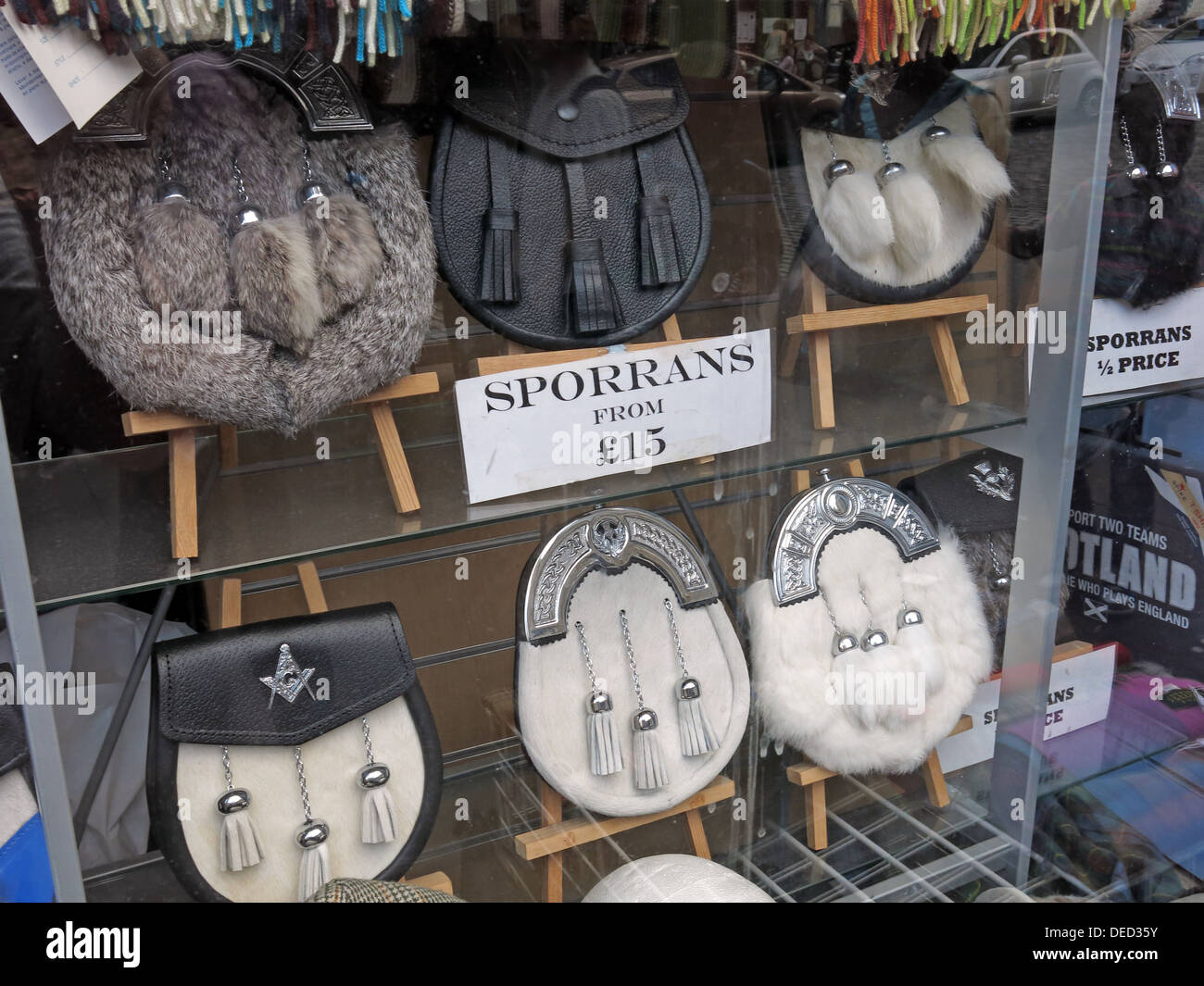 EH1,Scottish,Scot,scots,independance,independence,Sporrans,in,shops,window,display,traditional,dress,attire,hairy,furry,leather,plastic,scotsman,scotsmans,classic,horse,hair,horsehair,purse,male,highland,dress,belt-pouch,belt,pouch,wallet,Gotonysmith,tourist,tourism,travel,traveller,destination,thing,to,see,building,architecture,classic,old,buildings,cantle,may,have,a,set,stone,jewel,or,emblems,such,as,Saint,Andrew,a thistle,Clan,or Masonic symbols.,Buy Pictures of,Buy Images Of