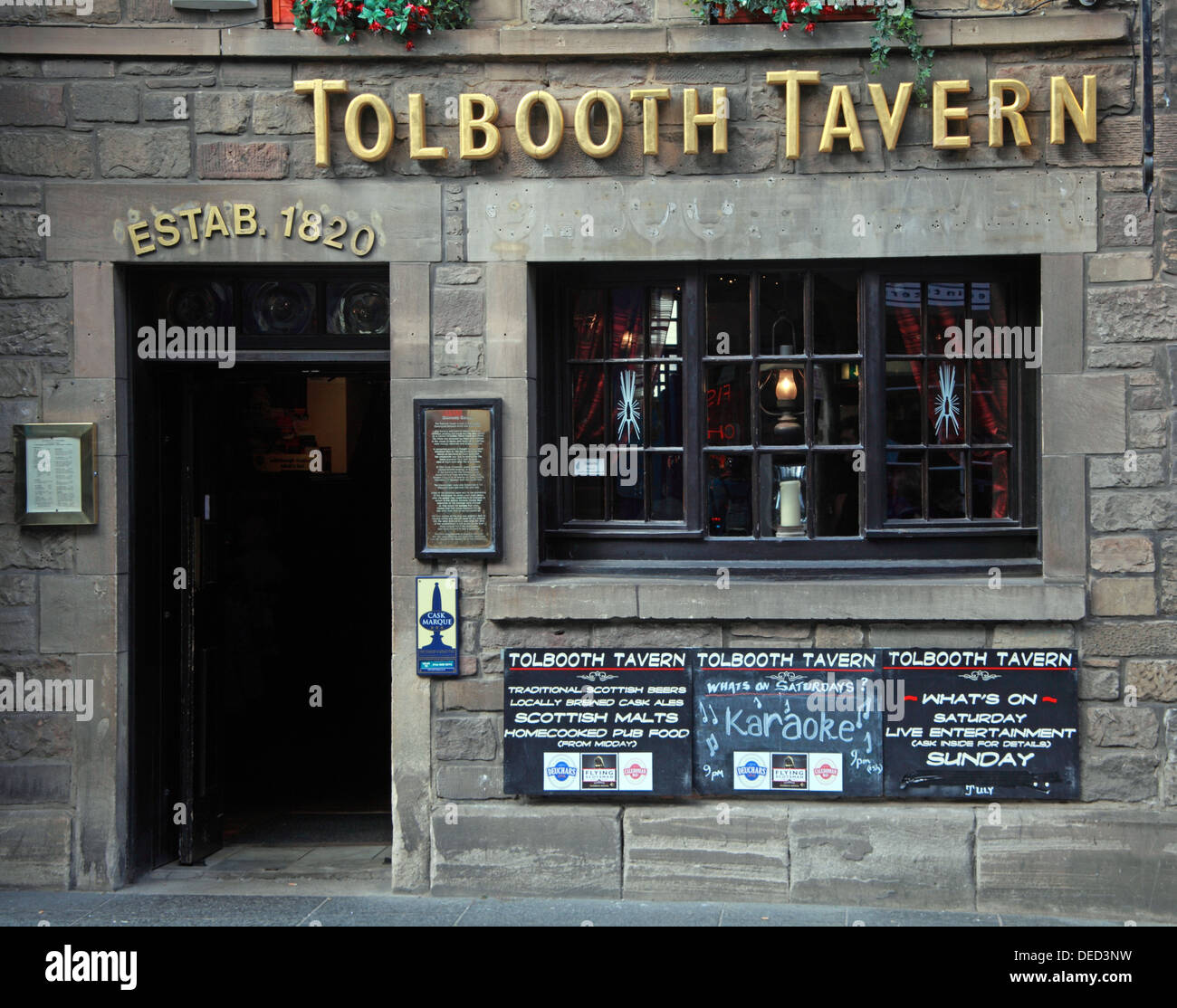 EH1,Scottish,Scot,scots,independance,independence,pubs,1820,cask,marque,boards,outside,blackboards,with,menu,menus,speccials,food,entertainment,Canongate,Tolbooth,is,a,historic,landmark,of,the,Old,Town,section,of,Edinburgh,Scotland,U.K.,built,in,1591,as,a,courthouse,burgh,Canongate,high,st,Gotonysmith,Council,Chamber,Police,Court,and,Prison,In,1875,the,City,Architect,Robert,Morham,completely,restored,and,remodelled,the,exterior,giving,it,back,its,medieval,look,(based,on,Gordon,of,Rothiemays,map,of,1647,This,work,included,remodelling,the,interior,to,create,museum,spaces,Rothiemays,street,cannongate,tourist,tourism,travel,traveller,destination,thing,to,see,building,architecture,classic,old,buildings,Buy Pictures of,Buy Images Of,Scotlands History,Scotlands History