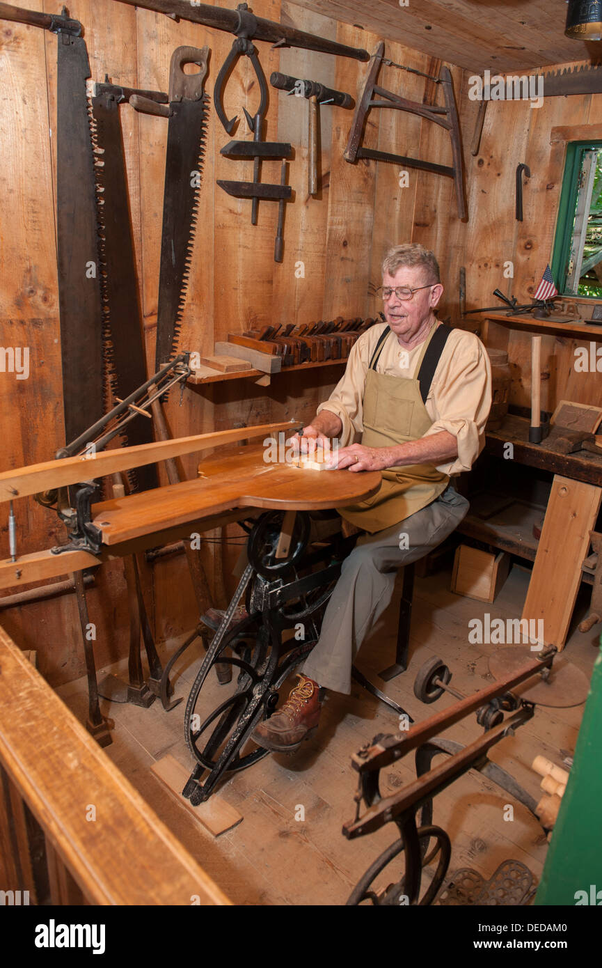 USA New Jersey NJ N.J. Cape May County Historic Cold Spring Village a docent using a pedal powered woodworking machine Stock Photo
