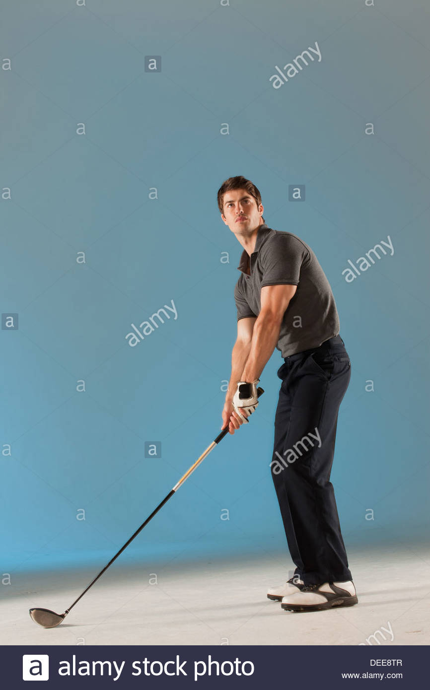 Golf player ready to swing club - Stock Image