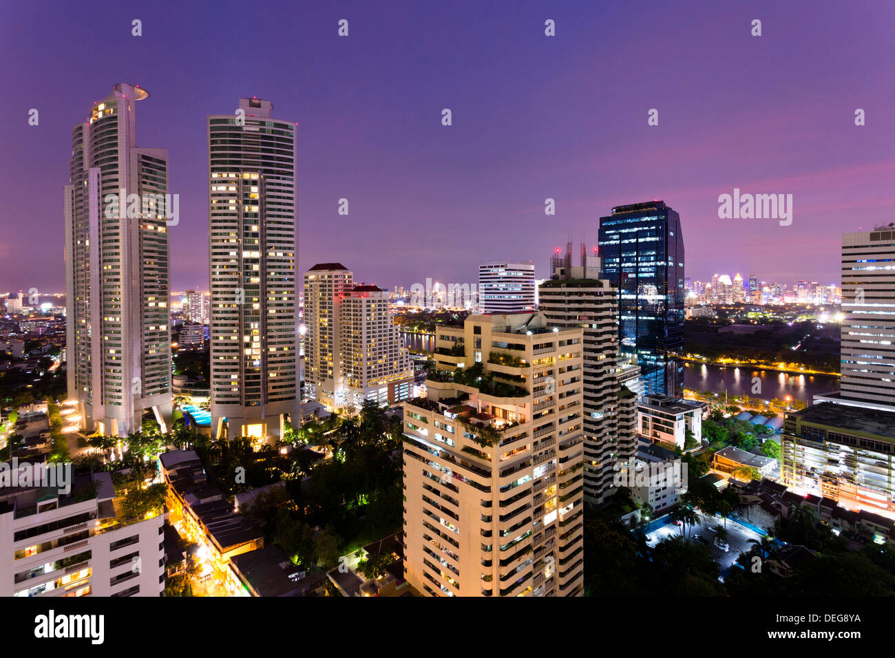 High rise buildings of Bangkok at night from Rembrandt Hotel and Towers, Sukhumvit 18, Bangkok, Thailand, Southeast - Stock Image