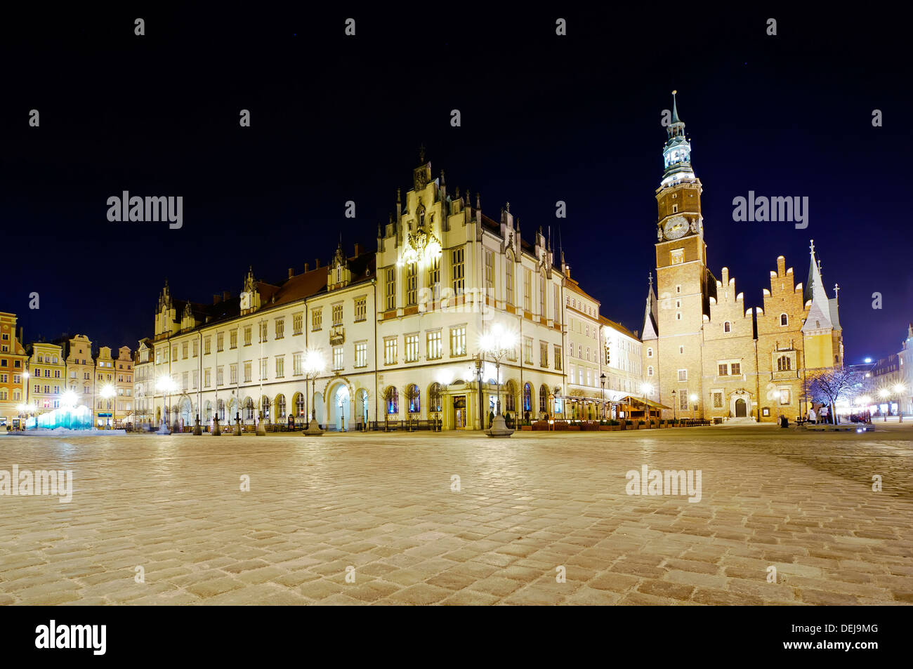 old and new city hall in wroclaw, poland, at night - Stock Image