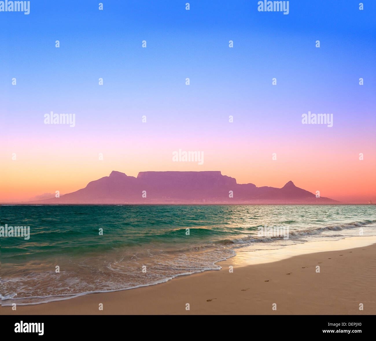 cape town from bloubergstrand at dusk sunset showing lights ocean and beach - Stock Image