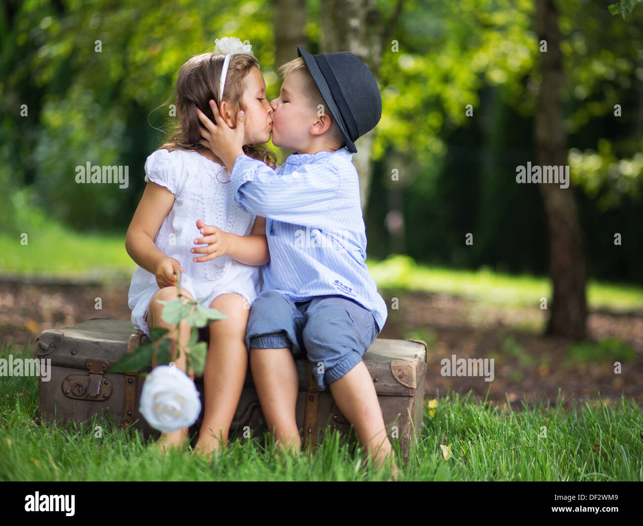 cute couple of kids kissing each other stock photo: 60915017 - alamy