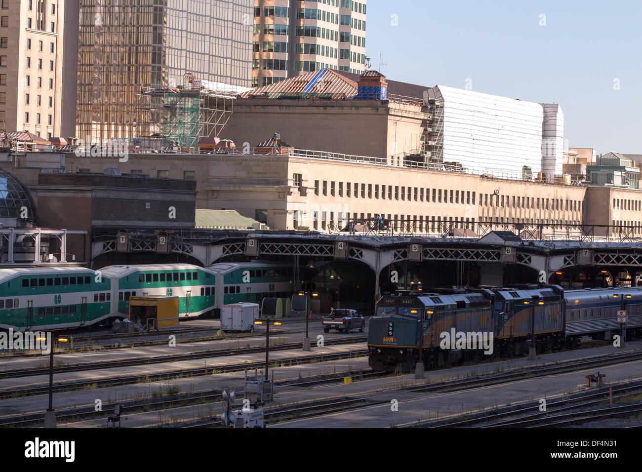 go-train-and-via-rail-train-leaving-unio
