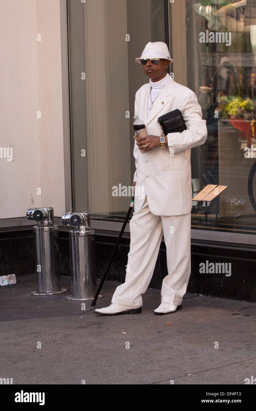 black-man-dressed-in-white-with-cane-and