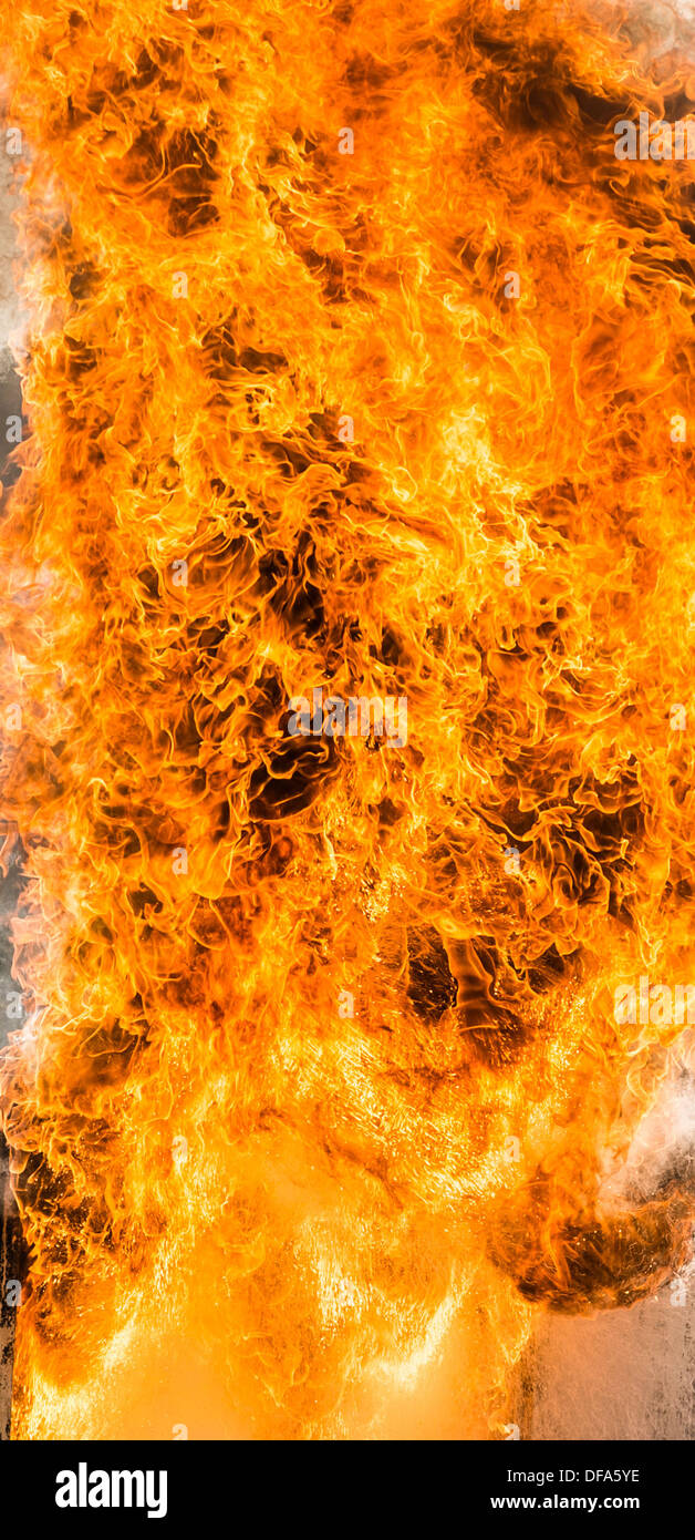 A Flame flames fire fires orange explosion - Stock Image