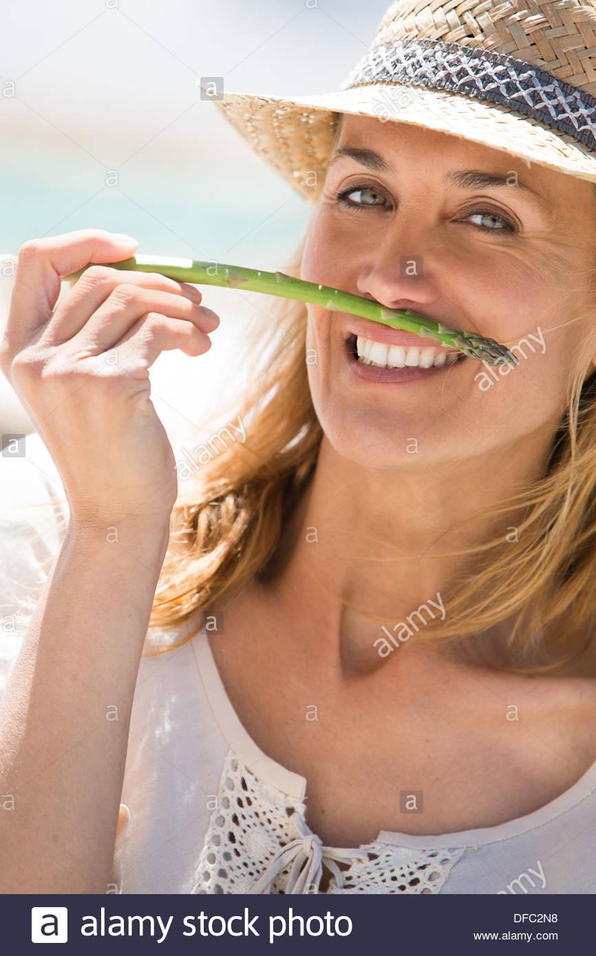 Woman humour asparagus - Stock Image