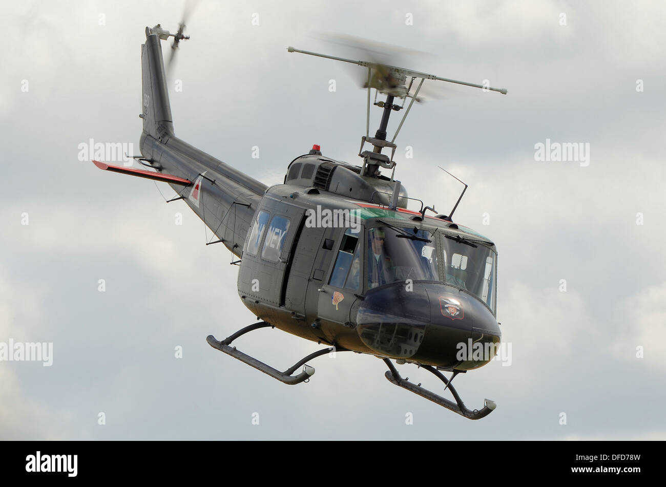 a-bell-uh-1-huey-helicopter-at-an-air-display-the-huey-is-the-image-DFD78W.jpg