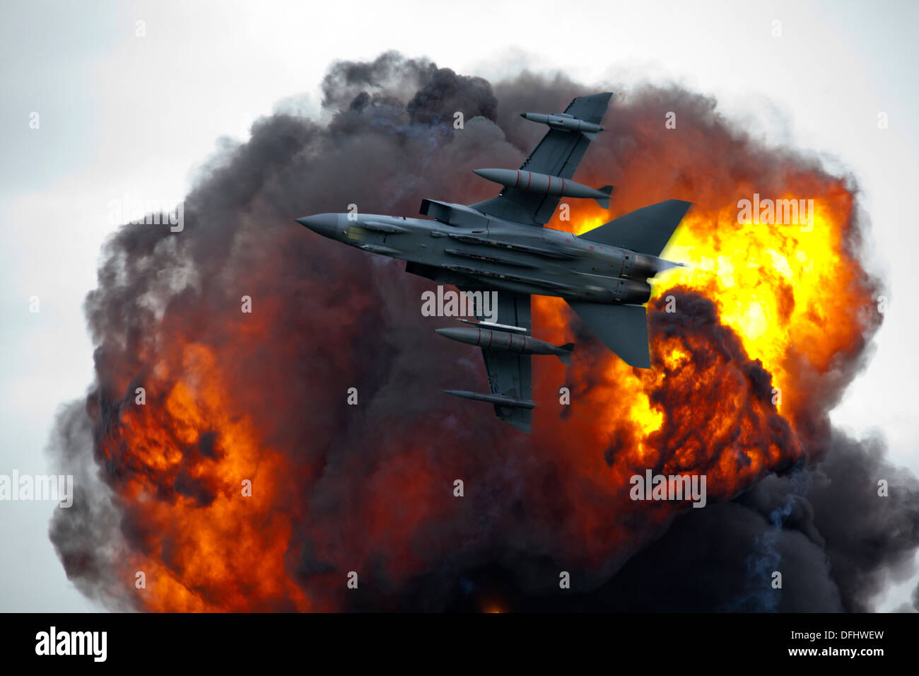 Jet fighter bomber in flight with explosion blast - Stock Image